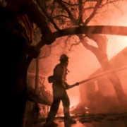 Firefighters battle the Woolsey Fire as it burns a home in Malibu in this file photo. (Photo: AP PHOTO)